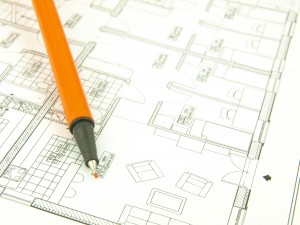 Plano de una casa con un bolígrafo.